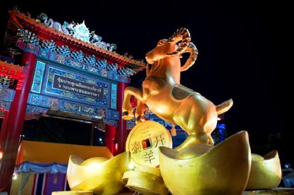 A golden statue of a goat